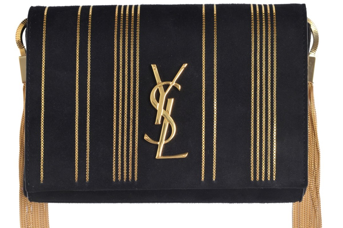 The Saint Laurent Kate chain bag in black suede and gold tassels costs US$2,875.
