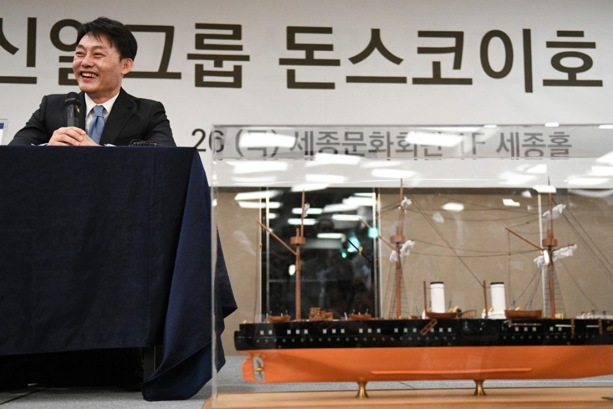 "Choi Yong-seok, chief executive of Shinil Group, with a model of the Russian Navy's Dmitrii Donskoi at a press conference on a ""Russian treasure ship"", in Seoul, on July 26, 2018. Picture: AFP"