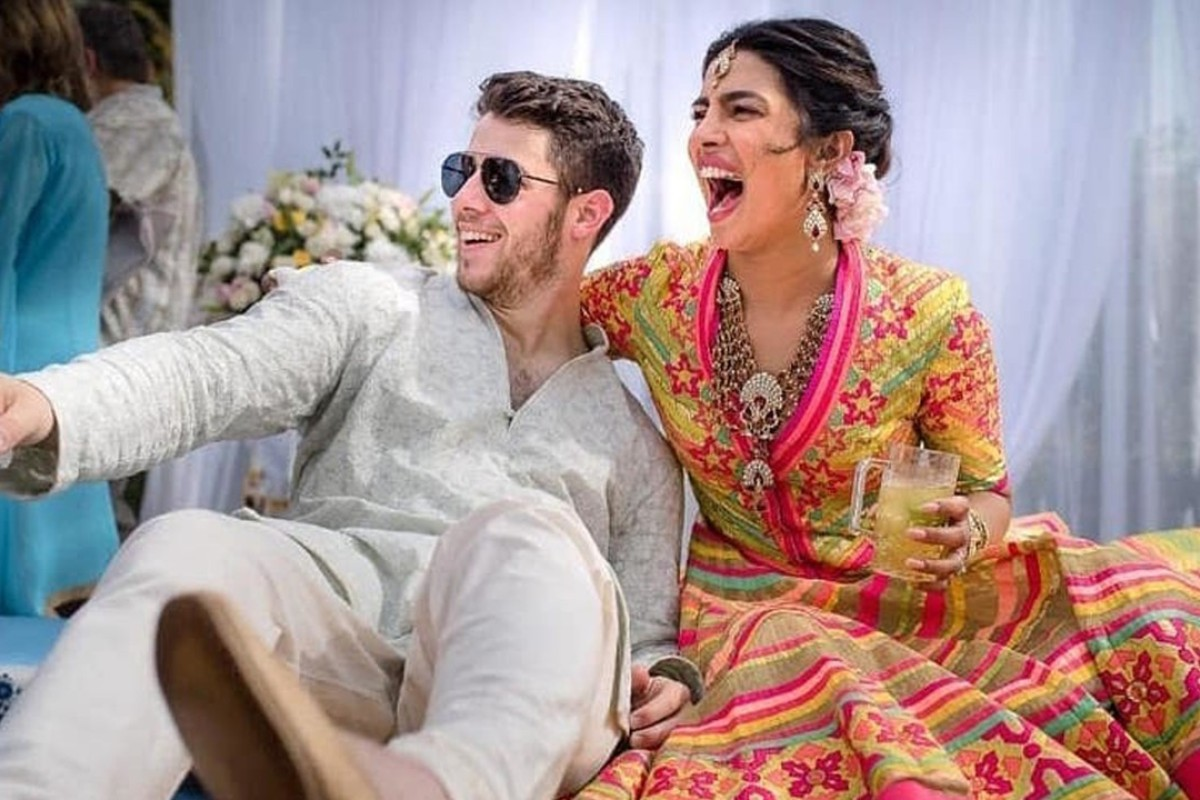 Bollywood actress Priyanka Chopra and Nick Jonas celebrate during a mehendi ceremony, a day before their wedding. Photo: Raindrop Media/AP