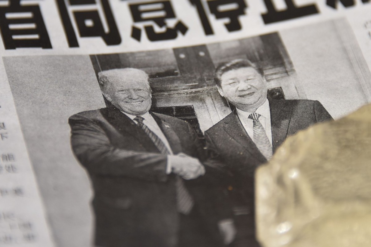 A Chinese newspaper covers the meeting between US President Donald Trump and Chinese President Xi Jinping. Photo: AFP