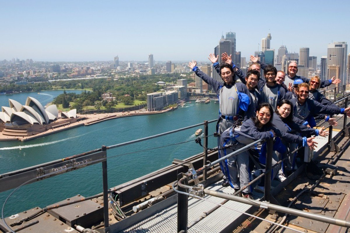 Climbers atop the Sydney Harbour Bridge. Picture: Alamy