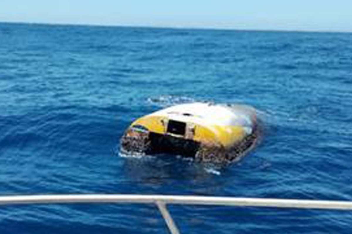 Californian Abby Sunderland's boat is spotted after eight years at sea, covered in barnacles and semi-submerged. Photo: South Australia Police