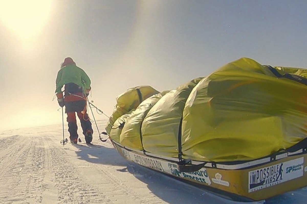 Colin O'Brady drags his sledge. Borge Ousland dragged his sledge too, but the use of a sail, no matter how small, means O'Brady can claim a first. Photos: Colin O'Brady via AP