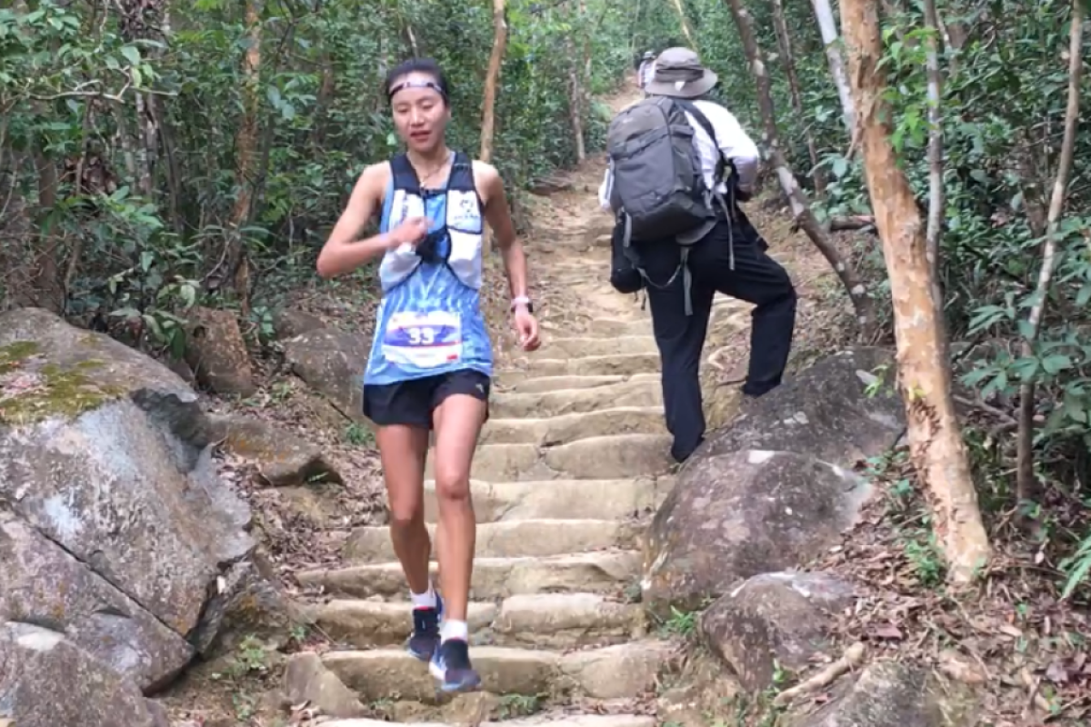 Yangchun Lu descends into checkpoint five far ahead of the second woman, but it was not until the final 3km that she thought she would win. Photos: Mark Agnew