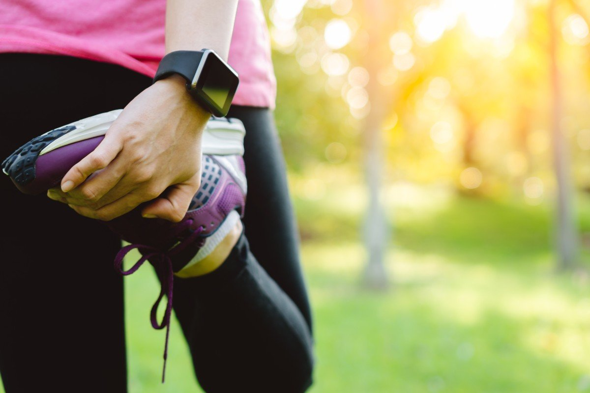 A runner stretches before a workout. But when did we start calling our leisure activities 'work'? Photo: Shutterstock