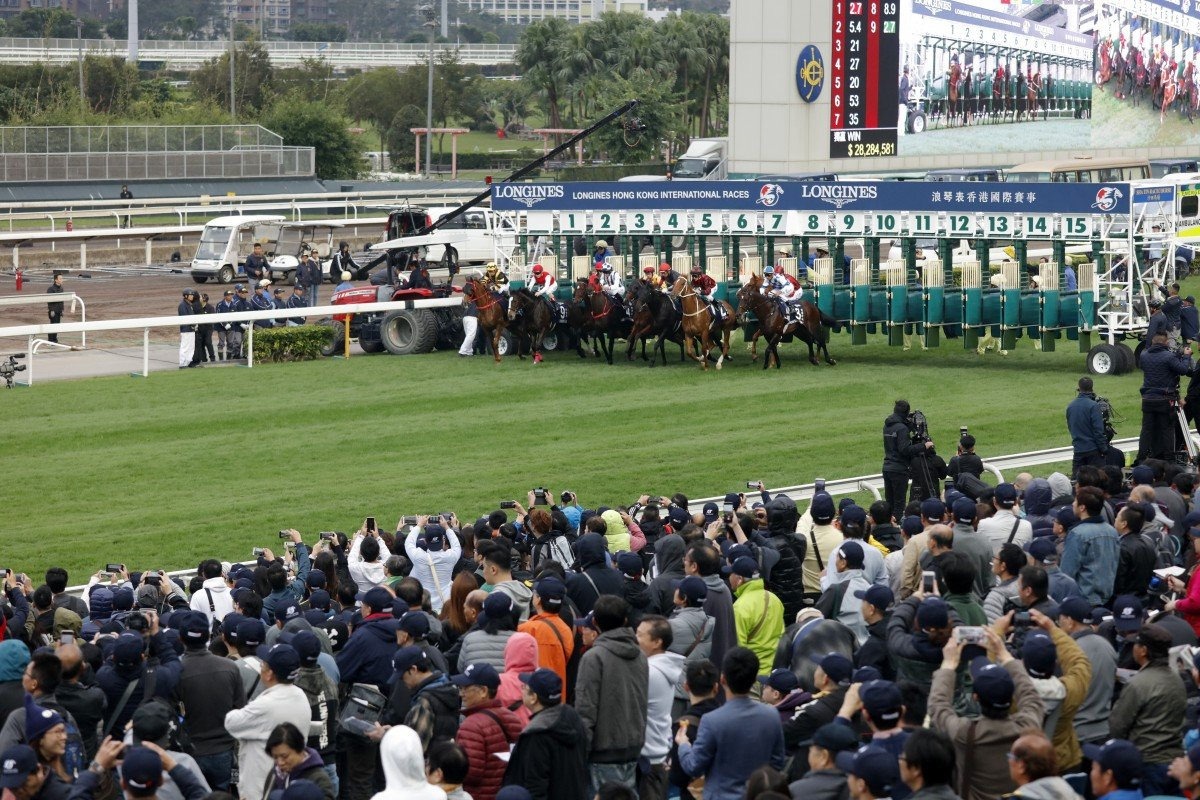 Horses jump from the gates in the 2018 Hong Kong Cup. Photos: Kenneth Chan
