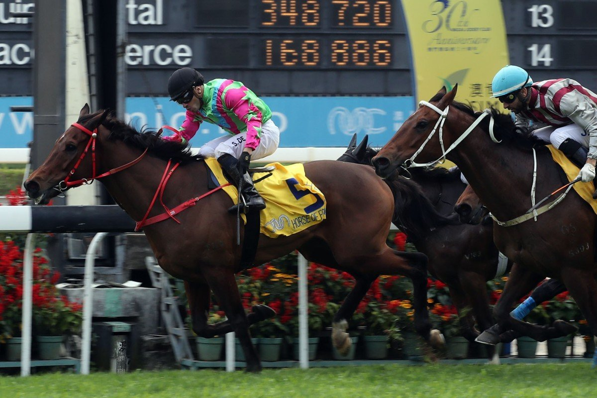Horse Of Fortune (Silvestre de Sousa) holds off Romantic Touch (Joao Moreira) in the Macau Hong Kong Trophy. Photo: HKJC