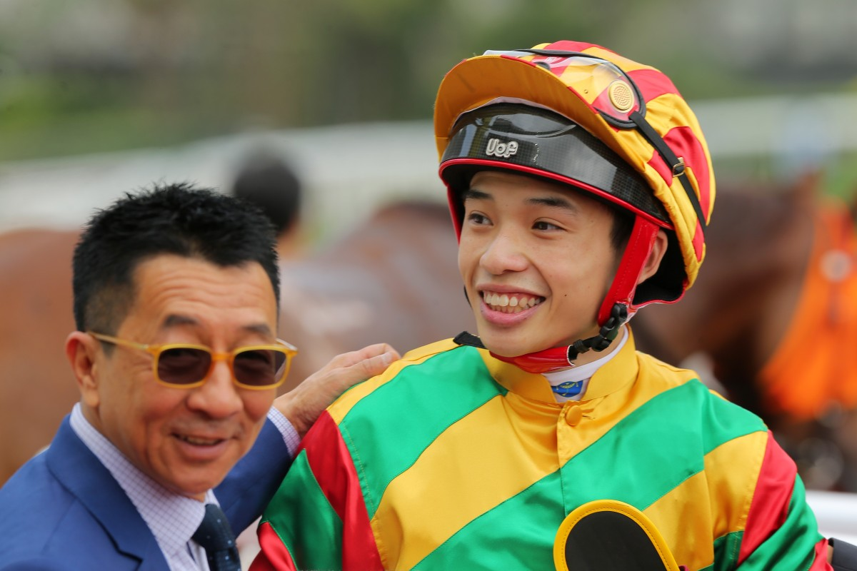 Trainer Me Tsui congratulates Jack Wong after they combined to win with Dragon Dance. Photos: Kenneth Chan