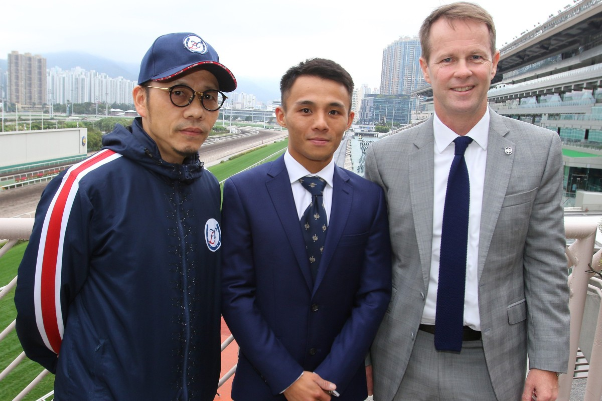 New apprentice jockey Alfred Chan (centre) with his boss Frankie Lor (left) and Jockey Club executive director of racing Andrew Harding at Sha Tin. Photos: Kenneth Chan