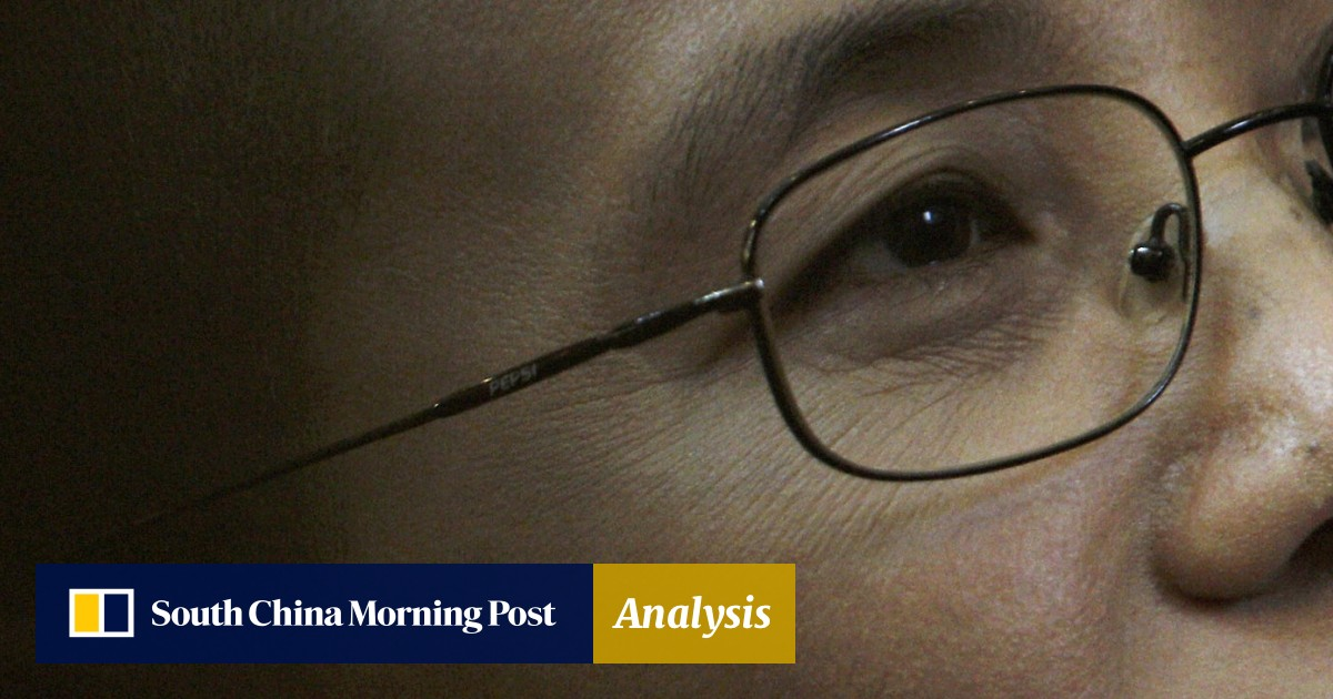 Liu Xiaobo's widow briefly emerges from house arrest during national