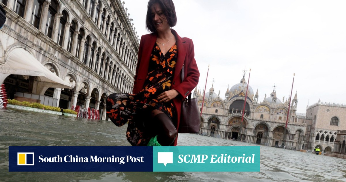 dbd4db93b Tourists wade through Venice as 70 per cent of city is immersed by ...