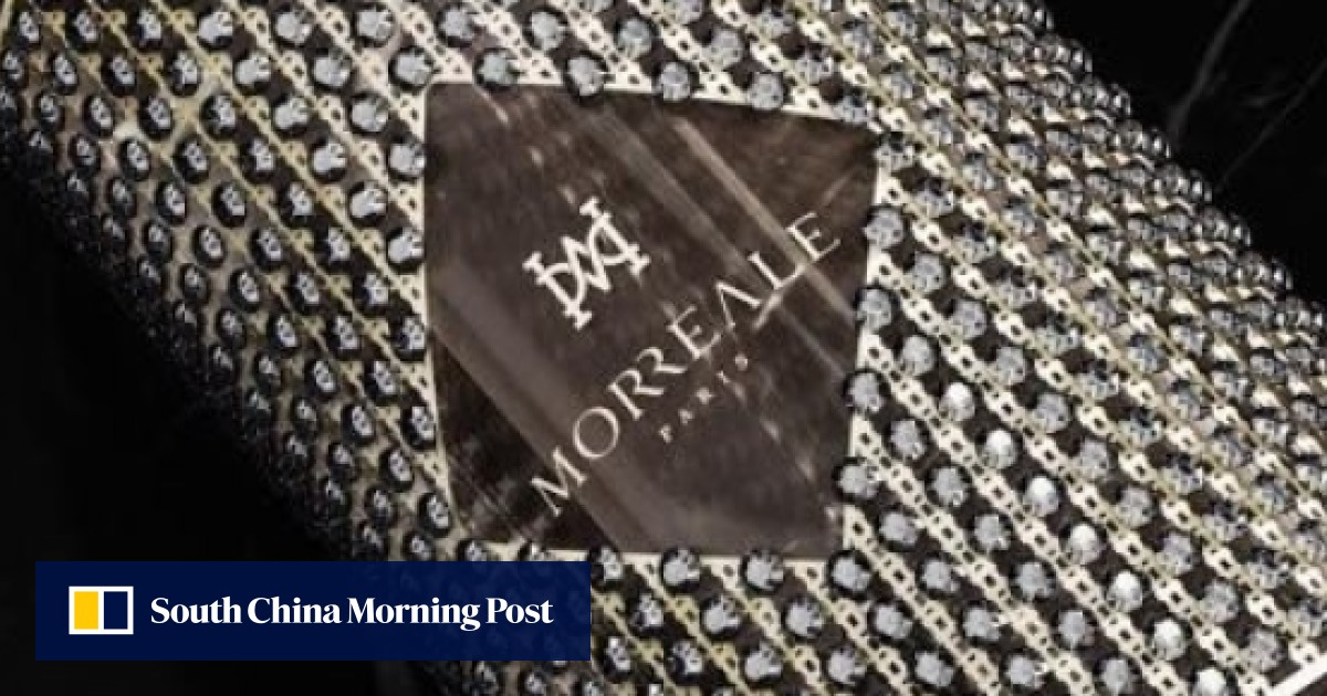 Which scent brand is offering a diamond-studded bottle for US$20 million?