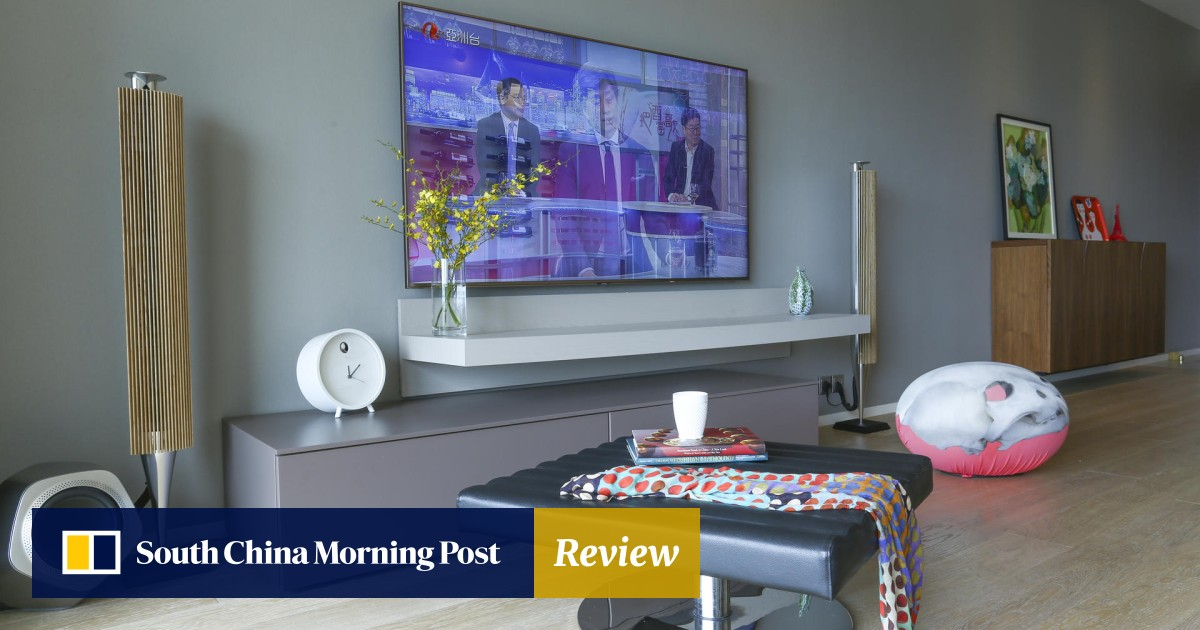 Two flats in Kowloon Tong turned into a modern duplex for a