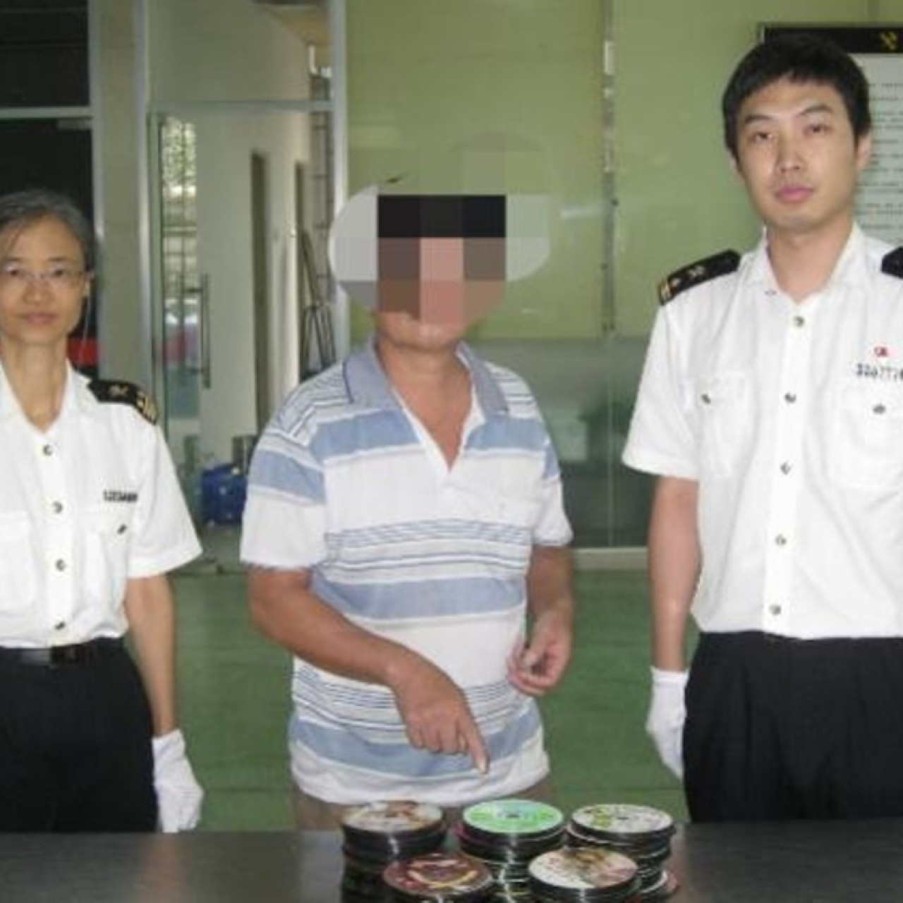 Hong Kong man arrested at border for carrying 276 porn DVDs ...